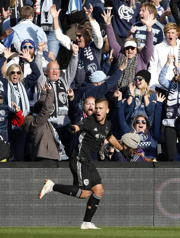 Sporting Kansas City forward Diego Rubio celebrates after scoring against Real Salt Lake during the first half of an MLS Western Conference semifinal soccer match in Kansas City, Kan., Sunday, Nov. 11, 2018. (AP Photo/Colin E. Braley)