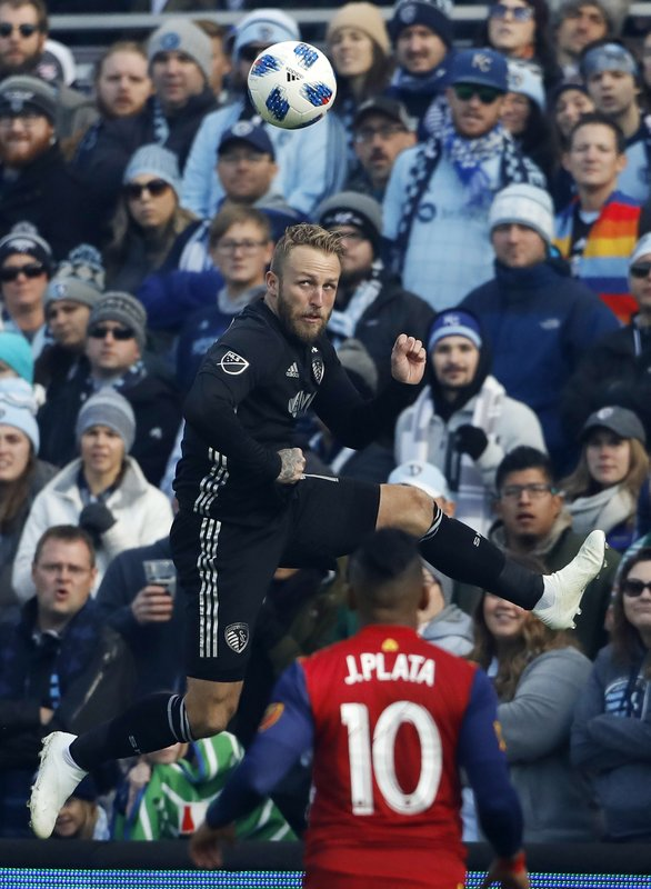 Sporting Kansas City forward Johnny Russell (7) heads the ball over Real Salt Lake forward Joao Plata (10) during the first half of a MLS Western Conference semifinals soccer match in Kansas City, Kan., Sunday, Nov. 11, 2018. (AP Photo/Colin E. Braley)