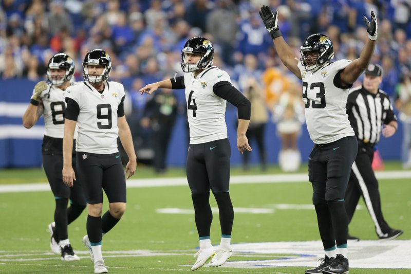 Jacksonville Jaguars kicker Josh Lambo (4) celebrates a field goal with Logan Cooke (9) and Calais Campbell (93) during the second half of an NFL football game against the Indianapolis Colts in Indianapolis, Sunday, Nov. 11, 2018. (AP Photo/AJ Mast)