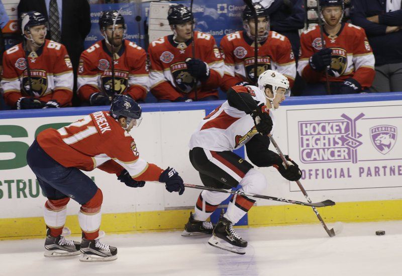 Ottawa Senators defenseman Maxime Lajoie (58) defends against Florida Panthers center Vincent Trocheck (21) during the first period of an NHL hockey game on Sunday, Nov. 11, 2018, in Sunrise, Fla. (AP Photo/Terry Renna)