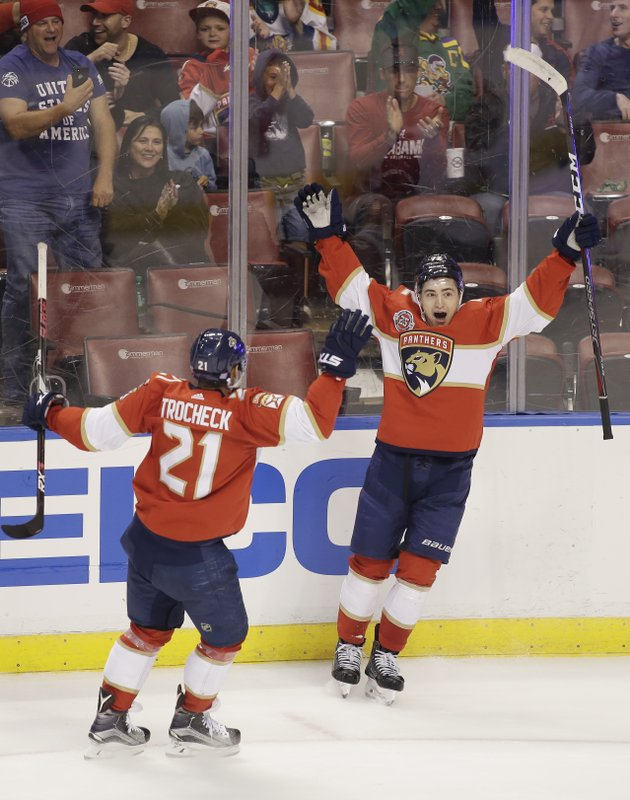 Florida Panthers center Frank Vatrano (72), right, celebrates with teammate Vincent Trocheck (21) after scoring a goal during the second period of an NHL hockey game against the Ottawa Senators on Sunday, Nov. 11, 2018 in Sunrise, Fla. (AP Photo/Terry Renna)