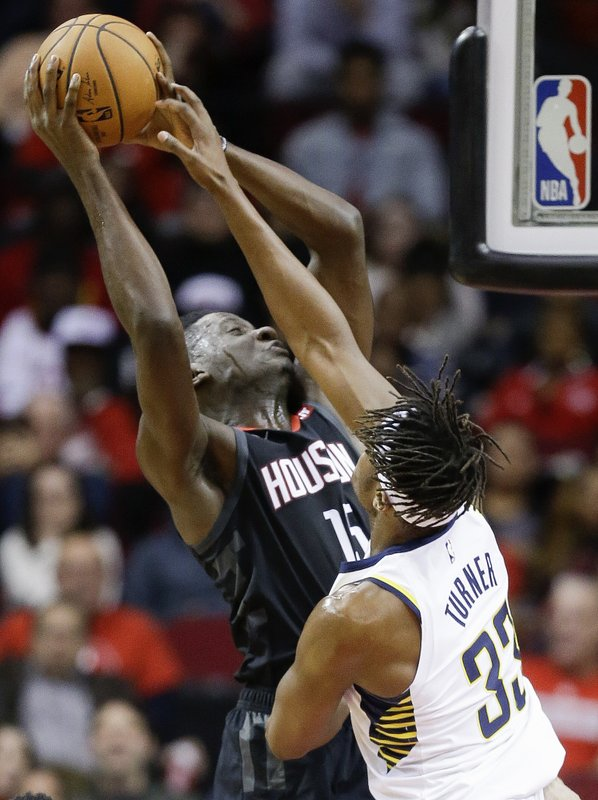 Houston Rockets center Clint Capela, left, drives to the basket as Indiana Pacers center Myles Turner defends during the first half of an NBA basketball game, Sunday, Nov. 11, 2018, in Houston. (AP Photo/Eric Christian Smith)