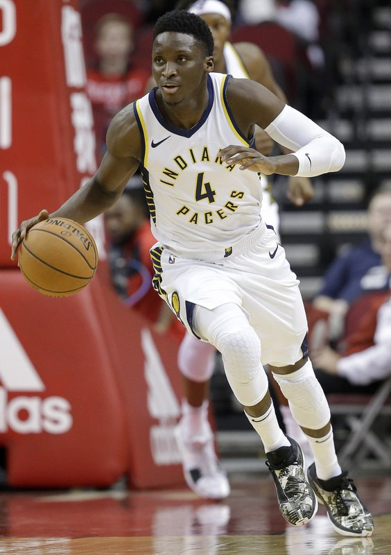 Indiana Pacers guard Victor Oladipo dribbles during the first half of an NBA basketball game against the Houston Rockets, Sunday, Nov. 11, 2018, in Houston. (AP Photo/Eric Christian Smith)