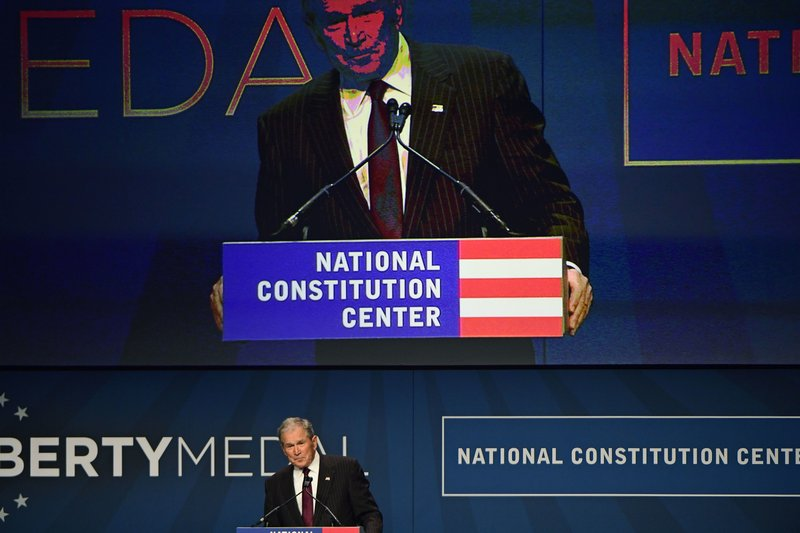 Former U.S. President George Bush speaks after receiving medals at the National Constitution Center in Philadelphia, Sunday, Nov. 11, 2018. He and his wife, first lady Laura Bush, were bestowed with the 30th annual Liberty Medal, an honor given to those who are committed to freedom and human rights globally. (AP Photo/Corey Perrine)