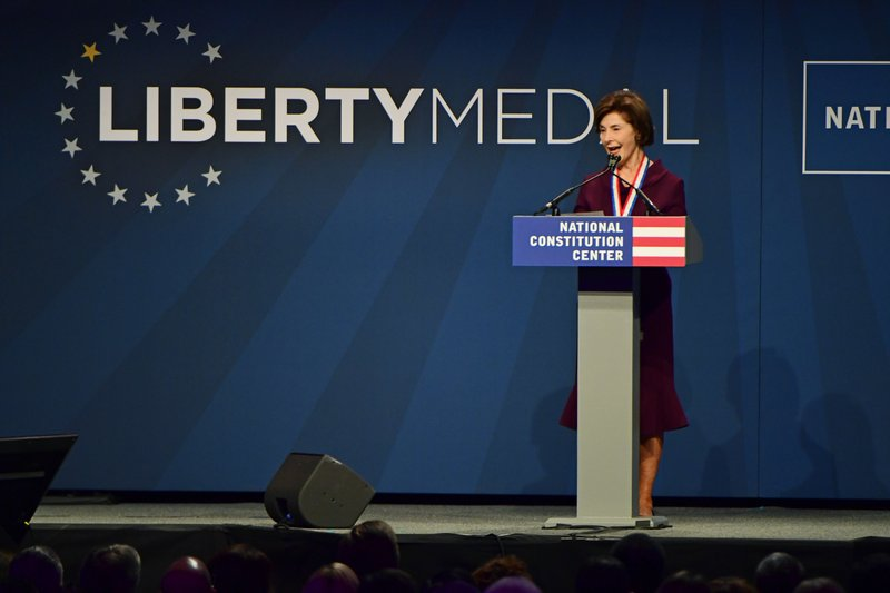 Former first lady Laura Bush speaks after receiving medals at the National Constitution Center in Philadelphia, Sunday, Nov. 11, 2018. She and her husband, former U.S. President George Bush, were bestowed with the 30th Annual Liberty Medal, an honor given to those who are committed to freedom and human rights globally. (AP Photo/Corey Perrine)