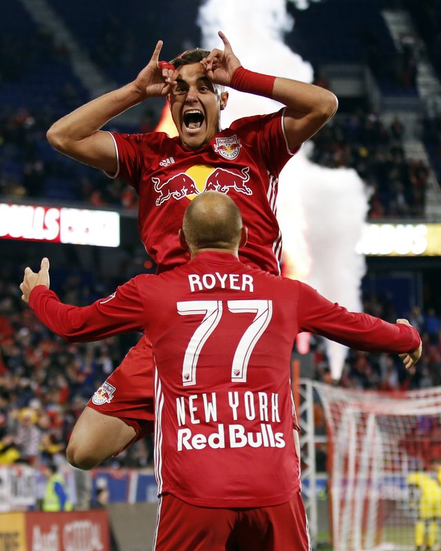 New York Red Bulls' Aaron Long celebrates scoring a goal with Red Bulls' Daniel Royer (77) against the Columbus Crew during the first half of a soccer game, Sunday, Nov. 11, 2018 in Harrison, N.J. (AP Photo/Adam Hunger)
