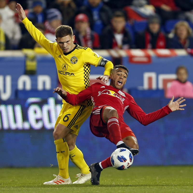 New York Red Bulls midfielder Tyler Adams (4) battles for the ball with Columbus Crew midfielder Will Trapp (6) during the first half of a soccer game, Sunday, Nov. 11, 2018 in Harrison, N.J. (AP Photo/Adam Hunger)