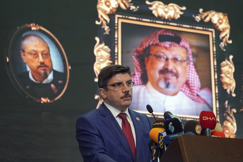 Yasin Aktay, an advisor to Turkey's President Recep Tayyip Erdogan, speaks during an event organized to mark the 40th day of the death of Saudi writer Jamal Khashoggi, in Istanbul, late Sunday, Nov. 11, 2018. Officials from Saudi Arabia, the United States, Germany, France and Britain have listened to audio recordings related to the killing of journalist Jamal Khashoggi at the Saudi Consulate in Istanbul, Erdogan said Saturday, Nov. 10. in the first public acknowledgement of the existence of tapes of the slaying.(AP Photo/Neyran Elden)