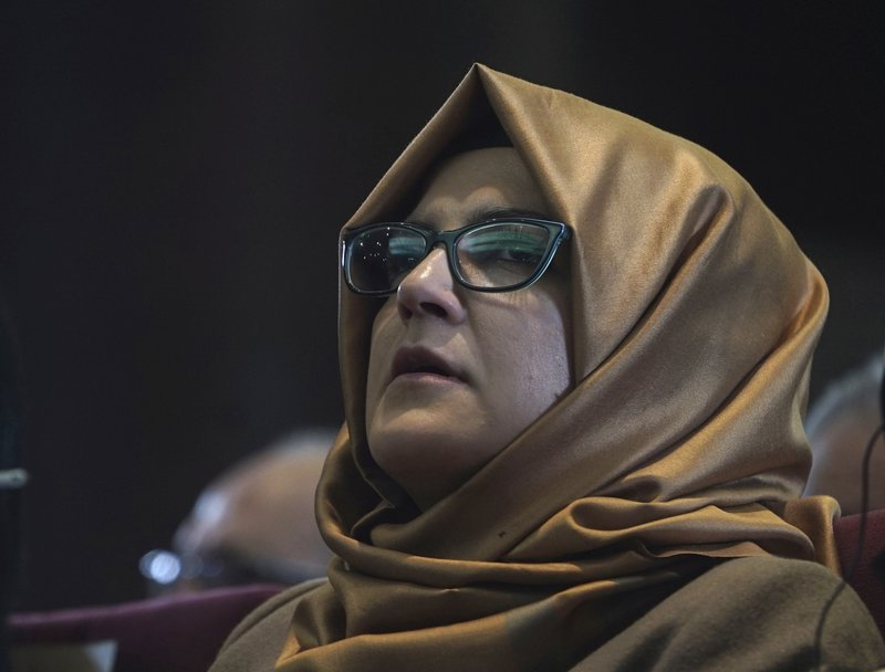 Hatice Cengiz, Turkish finance of slain journalist  Jamal Khashoggi, listens during an event organized to mark the 40th day of the death of the Saudi writer, in Istanbul, late Sunday, Nov. 11, 2018. Officials from Saudi Arabia, the United States, Germany, France and Britain have listened to audio recordings related to the killing of journalist Jamal Khashoggi at the Saudi Consulate in Istanbul, Turkey's President Recep Tayyip Erdogan said Saturday, Nov. 10, in the first public acknowledgement of the existence of tapes of the slaying.(AP Photo/Neyran Elden)