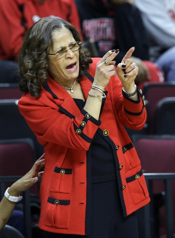 FILE - In this March 1, 2015, file photo, Rutgers head coach C. Vivian Stringer shouts to her players during the first half of an NCAA college basketball game against Indiana, in Piscataway, N.J. Stringer is one victory away from becoming the fifth Division I women's basketball coach to reach 1,000 victories. She'll get her first chance to join the exclusive club Tuesday night, Nov. 13, 2018, against Central Connecticut State. (AP Photo/Mel Evans, File)