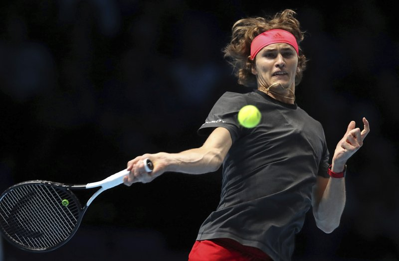 Alexander Zverev plays a return to Croatia's Marin Cilic during the ATP Men's Singles Final, at The O2 Arena in London, Monday Nov. 12, 2018. Cilic made 46 unforced errors as he gave up a break advantage in both sets in losing to Alexander Zverev on Monday. (Adam Davy/PA via AP)