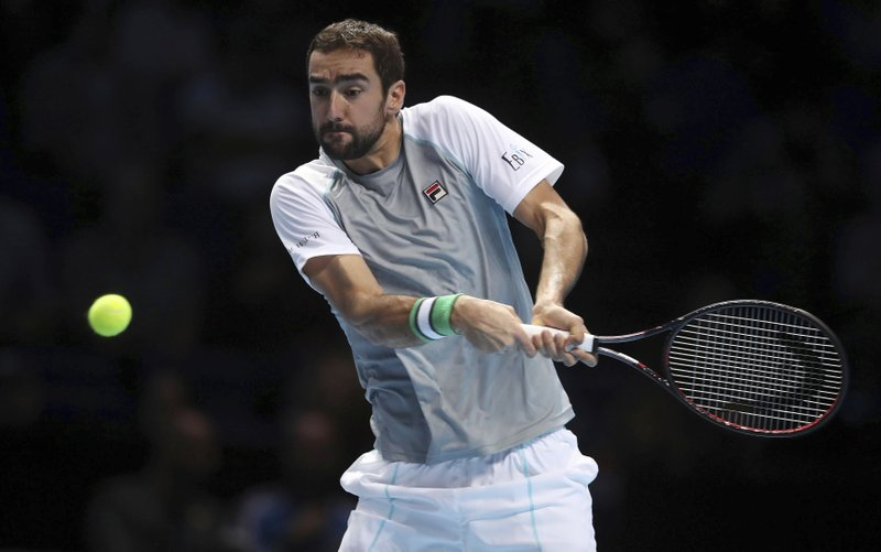 Croatia's Marin Cilic returns to Alexander Zverev during the ATP Men's Singles Final, at The O2 Arena in London, Monday Nov. 12, 2018. Cilic made 46 unforced errors as he gave up a break advantage in both sets in losing to Alexander Zverev on Monday. (Adam Davy/PA via AP)