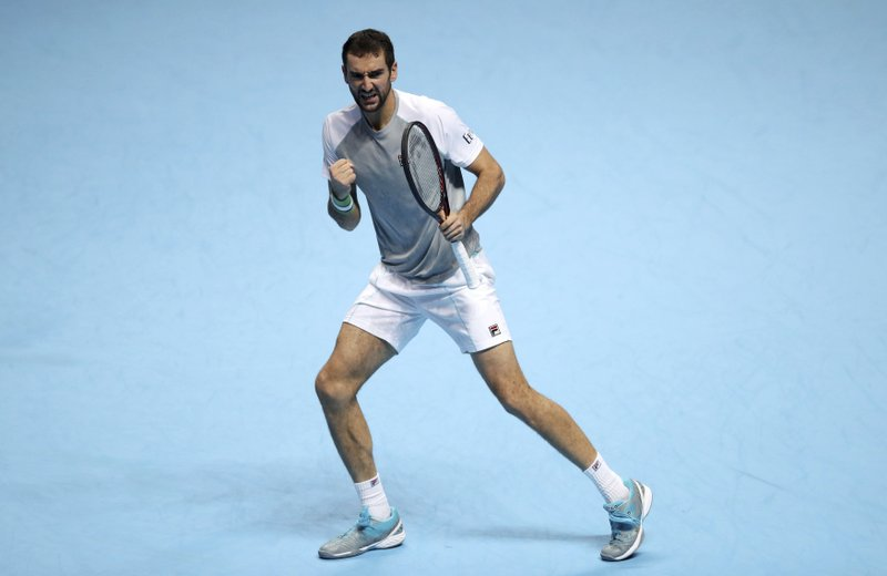 Croatia's Marin Cilic celebrates a point during the ATP Men's Singles Final against Alexander Zverev, at The O2 Arena in London, Monday Nov. 12, 2018. Cilic made 46 unforced errors as he gave up a break advantage in both sets in losing to Alexander Zverev on Monday. (Adam Davy/PA via AP)