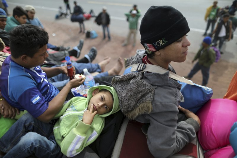 Central American migrant Angel Zelaya, 7, from Honduras, part of the caravan hoping to reach the U.S. border, rests on a truck in the road that connects Irapuato with Guadalajara, Mexico, Monday, Nov. 12, 2018. Several thousand Central American migrants marked a month on the road Monday as they hitched rides to the western Mexico city of Guadalajara and toward the U.S. border. (AP Photo/Rodrigo Abd)