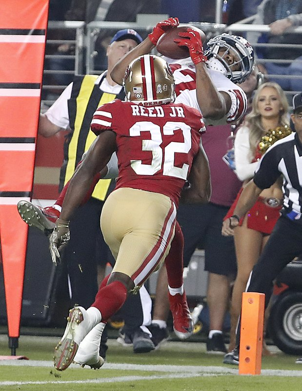 New York Giants wide receiver Sterling Shepard, top, catches a touchdown pass over San Francisco 49ers cornerback D.J. Reed Jr. (32) during the second half of an NFL football game in Santa Clara, Calif., Monday, Nov. 12, 2018. (AP Photo/Tony Avelar)