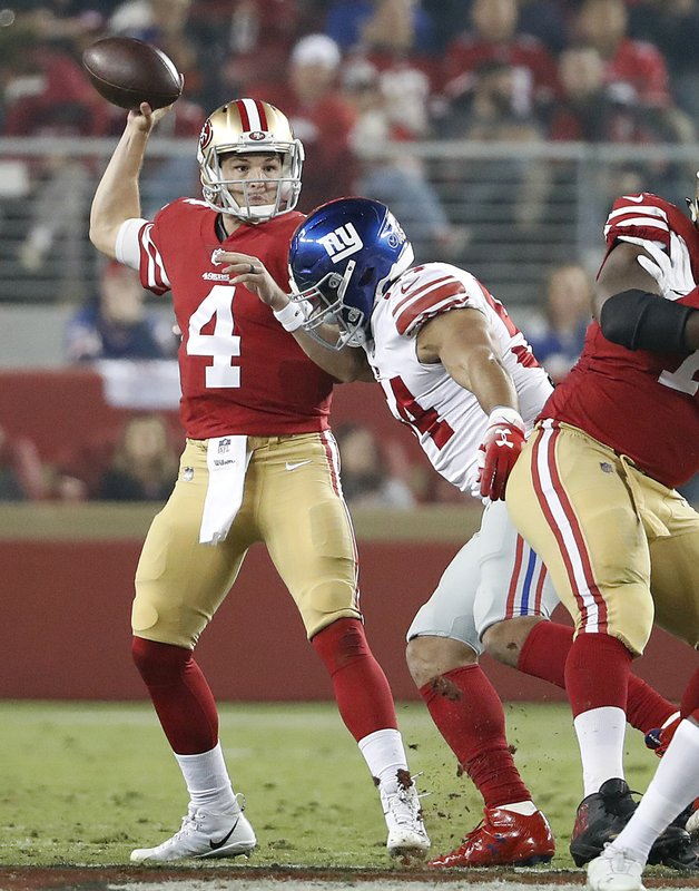 San Francisco 49ers quarterback Nick Mullens (4) passes against the New York Giants during the first half of an NFL football game in Santa Clara, Calif., Monday, Nov. 12, 2018. (AP Photo/Tony Avelar)