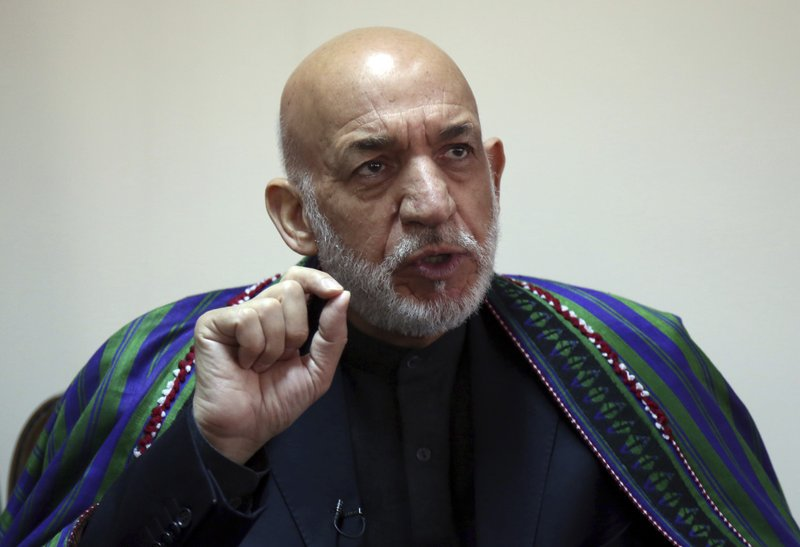 In this Nov. 1, 2018, photo, Afghanistan's former president Hamid Karzai speaks during an interview with the Associated Press in Kabul, Afghanistan. When U.S. forces and their Afghan allies rode into Kabul in November 2001 they were greeted as liberators. But after 17 years of war, the Taliban have retaken half the country, security is worse than it's ever been, and many Afghans place the blame squarely on the Americans. (AP Photo/Rahmat Gul)