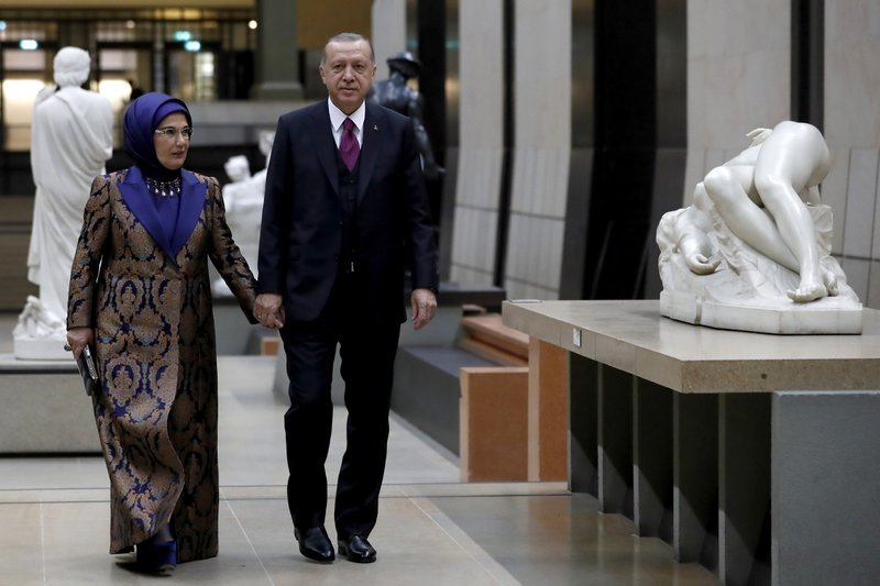 President of Turkey Recep Tayyip Erdogan and his wife Emine Erdogan arrive at the official dinner on the eve of the international ceremony for the Centenary of the WWI Armistice of 11 November 1918 at the Orsay Museum, in Paris, France, Saturday, Nov. 10, 2018. (Ian Langsdon/Pool Photo via AP)