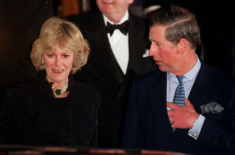 """FILE - In this Thursday, Jan. 28, 1999 file photo, Britain's Prince Charles and his companion Camilla Parker Bowles leave the Ritz Hotel in London, the first time that the couple, who have been friends for more than 25 years, have appeared together in public.  As Prince Charles turns 70 on Wednesday Nov. 14, 2018, Camilla says the public doesn't understand how """"incredibly kind"""" and funny Charles is. (AP Photo/Alastair Grant, File)"""