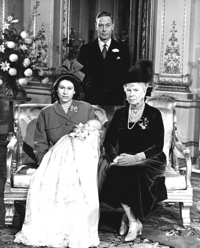 FILE - In this Dec. 15, 1948 file photo, Britain's Queen Elizabeth pictured with her first son, Prince Charles, her grandmother Queen Mary and father King George VI at Buckingham Palace on the day of his Christening. Prince Charles turns 70 Wednesday, Nov. 14, 2018 still serving in the heir to the throne role he has filled since he was a young child. (Pool Photo via AP, File)