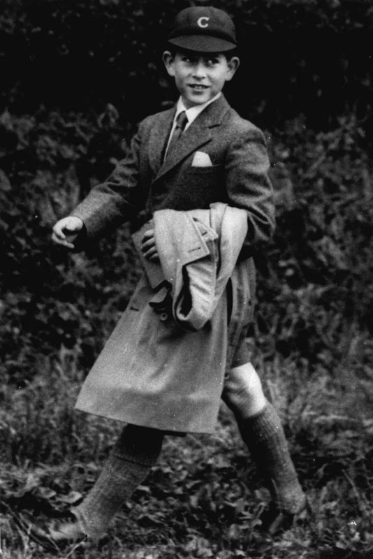 FILE - In this July 27, 1958  file photo, Britain's Prince Charles walks in his school uniform. Prince Charles turns 70 Wednesday, Nov. 14, 2018, serving as heir to the throne since he was a young child, but his destiny is to be king, a position he will automatically assume on the death of his mother, Queen Elizabeth II.  (AP Photo, File)