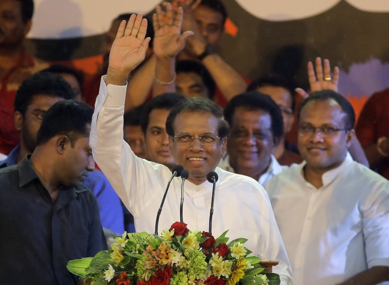 FILE - In this Monday, Nov. 5, 2018, file photo, Si Lankan President Maithripala Sirisena waves to supporters during a rally held outside the parliamentary complex in Colombo, Sri Lanka. The Sri Lankan Supreme Court suspends Sirisena's dissolution of Parliament; lawmakers to meet Wednesday amid crisis. (AP Photo/Eranga Jayawardena, File)