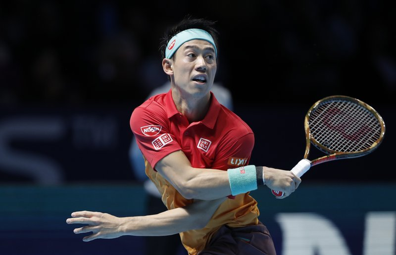 Kei Nishikori of Japan plays a return to Kevin Anderson of South Africa during their ATP World Tour Finals tennis match at the O2 arena in London, Tuesday, Nov. 13, 2018. (AP Photo/Alastair Grant)