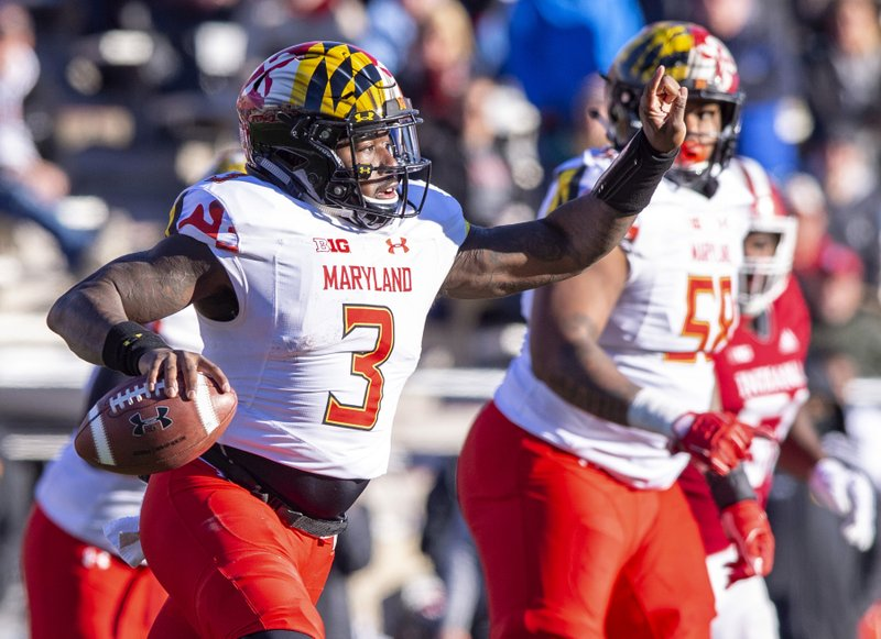 FILE - In this Nov. 10, 2018, file photo, Maryland quarterback Tyrrell Pigrome (3) scrambles out of the pocket looking for a receiver during the second half of an NCAA college football game against Indiana, in Bloomington, Ind. With No. 9 Ohio State next on the schedule, Maryland has yet another obstacle to overcome. Interim coach Matt Canada announced Tuesday, Nov. 13, 2018, that starting quarterback Kasim Hill tore the ACL in his left knee against Indiana last week, making this the second straight season he's had cut short with a knee injury. Tyrrell Pigrome will start against the Buckeyes (9-1, 6-1 Big Ten) as Maryland (5-5, 3-4) tries for a third straight week to get a win that will make them bowl eligible. (AP Photo/Doug McSchooler, File)