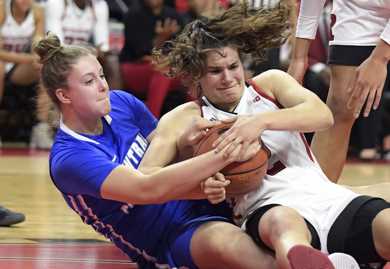 Central Connecticut center Carly Reynolds, left, and Rutgers guard Noga Peleg Pelc battle for control of the ball during the second quarter of an NCAA college basketball game, Tuesday, Nov. 13, 2018, in Piscataway, N.J. (AP Photo/Bill Kostroun)