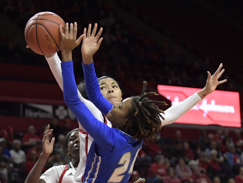 Rutgers forward Stasha Carey blocks a shot by Central Connecticut guard Forever Toppin (24) during the second quarter of an NCAA college basketball game, Tuesday, Nov. 13, 2018, in Piscataway, N.J. (AP Photo/Bill Kostroun)