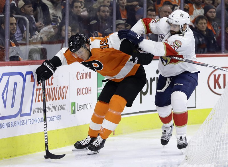 Philadelphia Flyers' Jori Lehtera, left, tries to keep Florida Panthers' Keith Yandle away from the puck during the second period of an NHL hockey game, Tuesday, Nov. 13, 2018, in Philadelphia. (AP Photo/Matt Slocum)