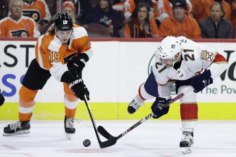 Florida Panthers' Vincent Trocheck (21) and Philadelphia Flyers' Nolan Patrick (19) battle for the puck during the first period of an NHL hockey game, Tuesday, Nov. 13, 2018, in Philadelphia. (AP Photo/Matt Slocum)