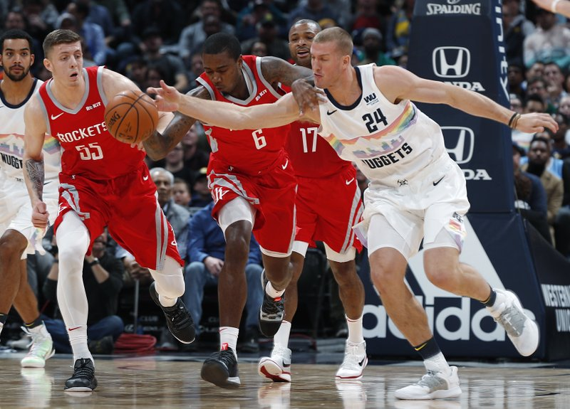 From left, Houston Rockets forwards Isaiah Hartenstein and Gary Clark pursue a loose ball with Denver Nuggets forward Mason Plumlee in the first half of an NBA basketball game, Tuesday, Nov. 13, 2018, in Denver. (AP Photo/David Zalubowski)
