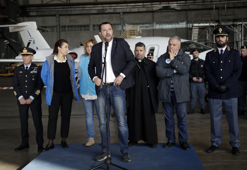 Italian Interior Minister and Deputy Premier Matteo Salvini speaks to reporters after the arrival of a group of refugees and asylum seekers in Pratica di Mare's military airport, near Rome, Wednesday, Nov. 14, 2018. A group of 51 refugees and asylum seekers from Sudan, Ethiopia, Eritrea, Somalia and Cameroon, arrived in Italy from Niger, where they had been transferred to after being held in Libyan detention centers. (AP Photo/Alessandra Tarantino)