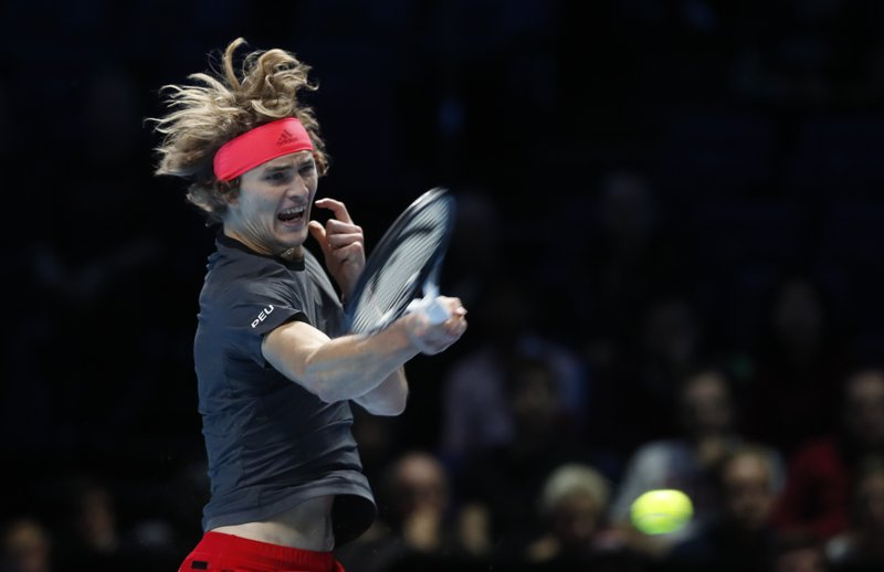 Alexander Zverev of Germany plays a return to Novak Djokovic of Serbia during their ATP World Tour Finals men's singles tennis match at the O2 arena in London, Wednesday, Nov. 14, 2018. (AP Photo/Alastair Grant)