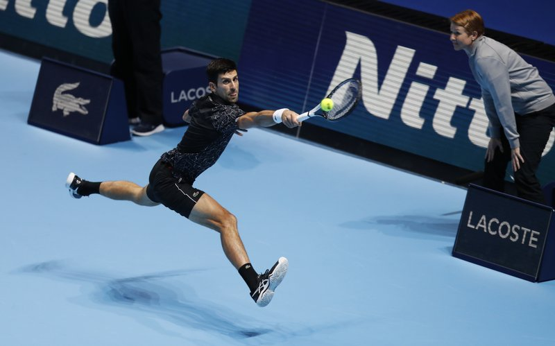 Novak Djokovic of Serbia plays a return to Alexander Zverev of Germany during their ATP World Tour Finals men's singles tennis match at the O2 arena in London, Wednesday, Nov. 14, 2018. (AP Photo/Alastair Grant)
