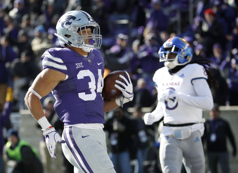 Kansas State running back Alex Barnes (34) runs into the end zone to score a touchdown during the second half of an NCAA college football game against Kansas, Saturday, Nov. 10, 2018, in Manhattan, Kan. Kansas State won 21-17. (AP Photo/Charlie Riedel)