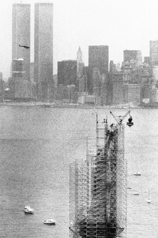 FILE - This July 4,1984 file photo shows the original torch of the Statue of Liberty after it was removed from her grasp, in New York. The torch, which was replaced by a replica, was moved into what will become its permanent home at a new museum on Liberty Island. (AP Photo/David Pickoff, File)