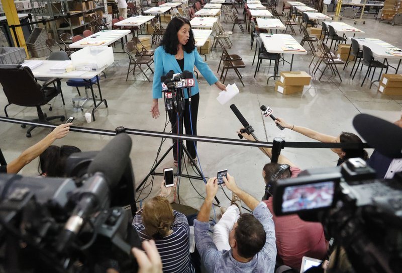 Palm Beach County Supervisor Of Elections Susan Bucher speaks to members of the media at the Supervisor of Elections office after the deadline for a recount was reached, Thursday, Nov. 15, 2018, in West Palm Beach, Fla. (AP Photo/Wilfredo Lee)