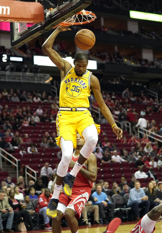 Golden State Warriors' Kevin Durant (35) dunks the ball against the Houston Rockets during the first half of an NBA basketball game Thursday, Nov. 15, 2018, in Houston. (AP Photo/David J. Phillip)