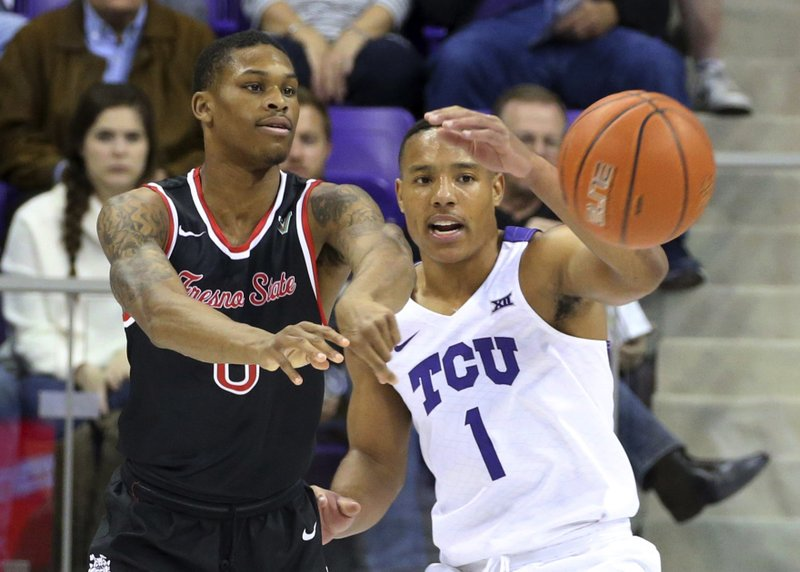 Fresno State guard New Williams (0) passes the ball away under pressure from TCU guard Desmond Bane (1) in the first half of an an NCAA college basketball game Thursday, Nov. 15, 2018, in Fort Worth, Texas. (AP Photo/Richard W. Rodriguez)