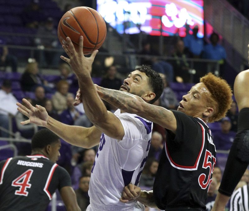 TCU guard Alex Robinson (25) is fouled by Fresno State guard Noah Blackwell (55) during the first half of an NCAA college basketball game Thursday, Nov. 15, 2018, in Fort Worth, Texas. (AP Photo/Richard W. Rodriguez)