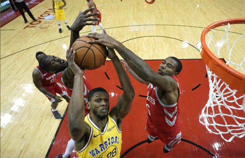 Golden State Warriors' Alfonzo McKinnie (28) goes up for a shot as Houston Rockets' Gary Clark (6) and James Ennis III defend during the second half of an NBA basketball game Thursday, Nov. 15, 2018, in Houston. The Rockets won 107-86. (AP Photo/David J. Phillip)