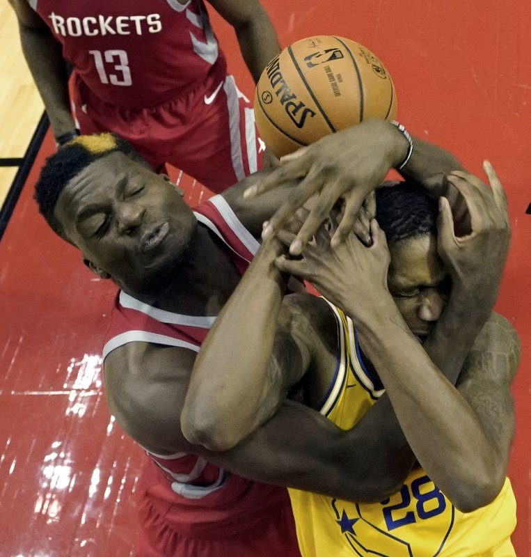 Golden State Warriors' Alfonzo McKinnie (28) is fouled by Houston Rockets' Clint Capela during the second half of an NBA basketball game Thursday, Nov. 15, 2018, in Houston. The Rockets won 107-86.(AP Photo/David J. Phillip)