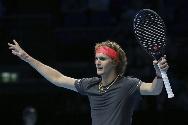 Alexander Zverev of Germany celebrates winning match point against John Isner of the United States in their ATP World Tour Finals singles tennis match at the O2 Arena in London, Friday Nov. 16, 2018. (AP Photo/Tim Ireland)