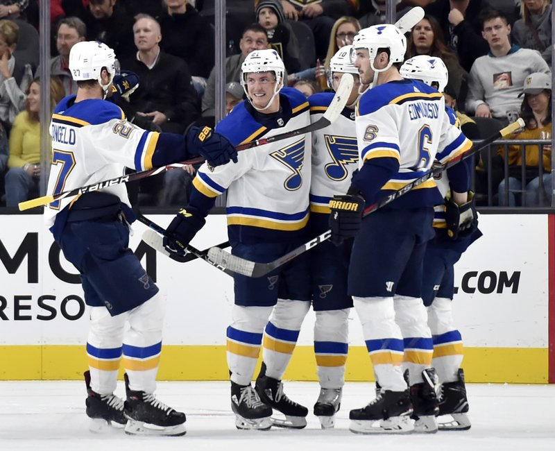 The St. Louis Blues celebrate a goal against the Vegas Golden Knights during the second period of an NHL hockey game Friday, Nov. 16, 2018, in Las Vegas. (AP Photo/David Becker)