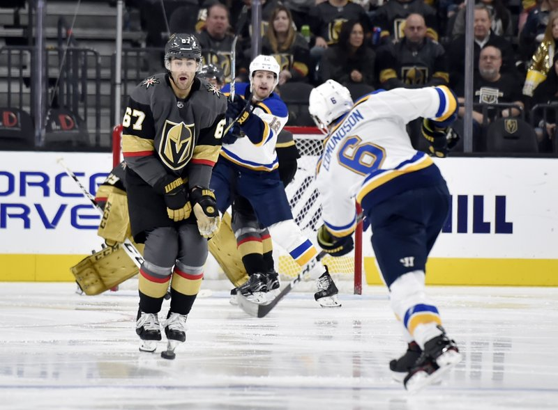 St. Louis Blues defenseman Joel Edmundson (6) shoots the puck against Vegas Golden Knights left wing Max Pacioretty during the second period of an NHL hockey game Friday, Nov. 16, 2018, in Las Vegas. (AP Photo/David Becker)