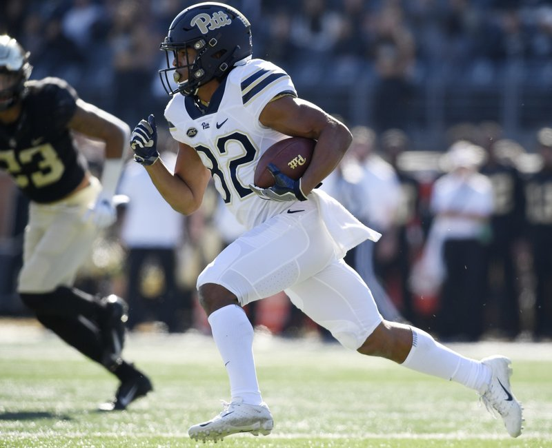 Pittsburgh's Rafael Araujo-Lopes (82) runs upfield for a gain against Wake Forest during the first half of their NCAA college football game against Saturday, Nov. 17, 2018 in Winston-Salem, N.C. (AP Photo/Woody Marshall)