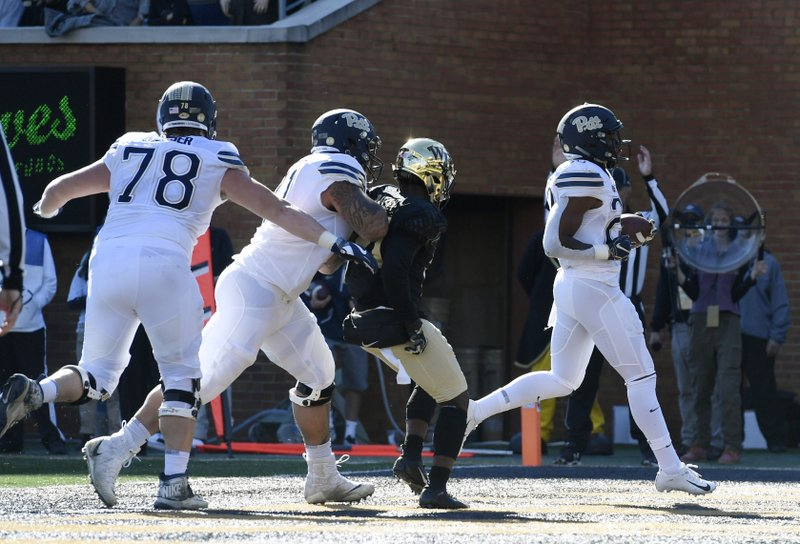 Pittsburgh's Darrin Hall (22) runs into the end zone for a touch down (22) against Wake Forest during the first half of their NCAA college football game Saturday, Nov. 17, 2018 in Winston-Salem, N.C. (AP Photo/Woody Marshall)