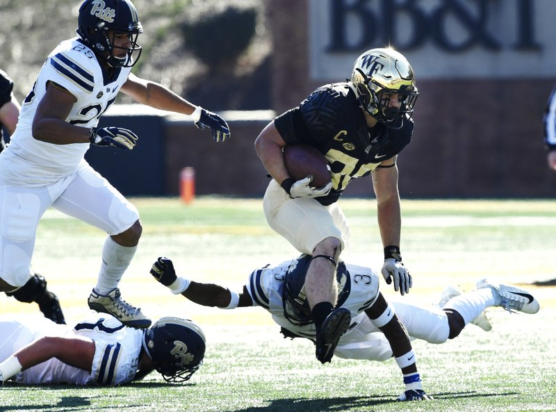 Wake Forest's Cade Carney (36) during the first half of their NCAA college football game against Pittsburgh on Saturday, Nov. 17, 2018 in Winston-Salem, N.C. (AP Photo/Woody Marshall)